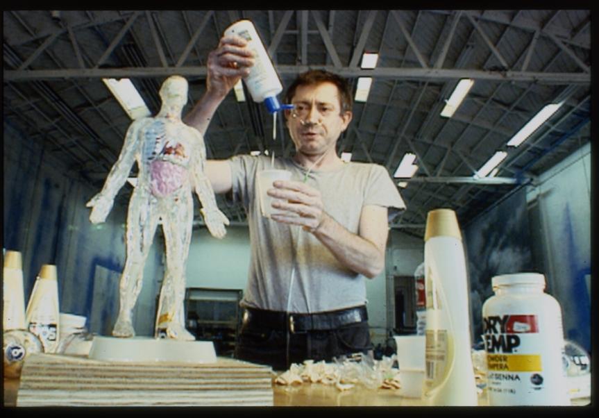 bob_flanagan_demonstrating_the_making-of_his_visible_man_sculpture