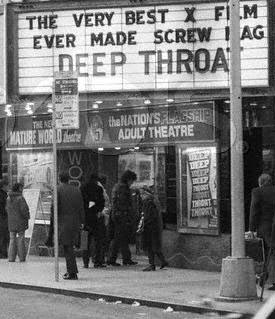 """1973, Times Square, Manhattan, New York, New York, USA --- 2/1973-New York, New York-Marquee of The New Mature World Theatre which is showing the porno-film, """"Deep Throat."""" West 49th Street. --- Image by © Bettmann/CORBIS"""