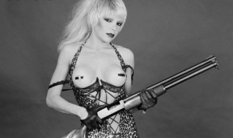 November 1980 --- Singer Wendy O. Williams Barechested and Holding a Shotgun --- Image by © Lynn Goldsmith/Corbis